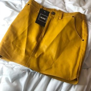 leather yellow skirt